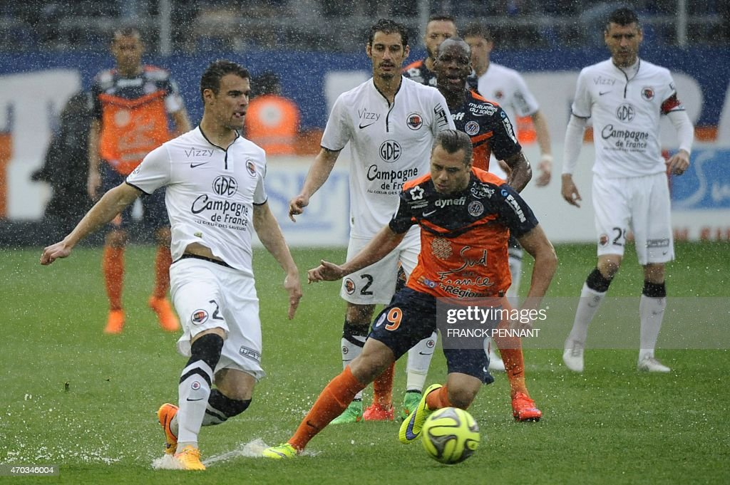 Caen's French defender Damien Da Silva (L) vies with Montpellier's French forward Kevin Berigaud during the French L1 football match between Montpellier and Caen at Mosson Stadium in Montpellier, southern France, on April 19, 2015. AFP PHOTO / FRANCK PENNANT