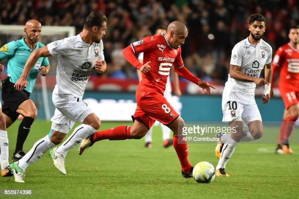 Caen's French defender Damien Da Silva vies with Rennes' Tunisian midfielder Wahbi Khazri during the French L1 football match between Stade Rennais...