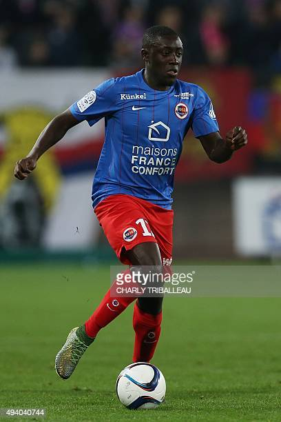 Caen's French defender Dennis Appiah runs with the ball during the French L1 football match between Caen and Nantes on October 23 at the Michel...