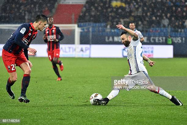 Caen's French defender Frederic Guilbert fights for the ball with Lyon's French forward Mathieu Valbuena during the French L1 football match between...
