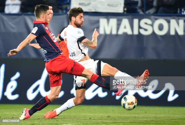Caen's French defender Frederic Guilbert vies for the ball with Montpellier's French midfielder Paul Lasne during the French L1 football match...