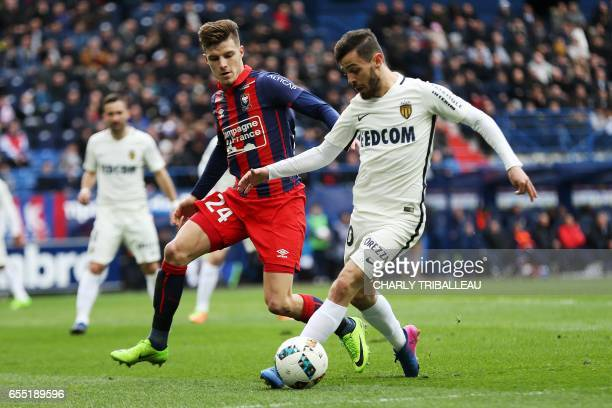 Caen's French defender Frederic Guilbert vies with Monaco's Portuguese midfielder Bernardo Silva during the French L1 football match between Caen and...