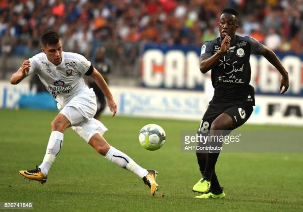 Caen's French defender Frederic Guilbert vies with Montpellier's French forward Isaac Mbenza during the French L1 football match between MHSC...