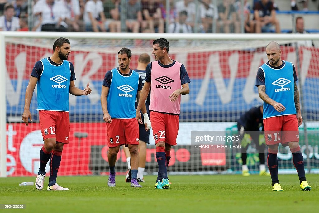 Caen's French defender Syam Ben Youssef Caen's French midfielder Nicolas Seube Caen's French midfielder Julien Feret and Caen's French midfielder...