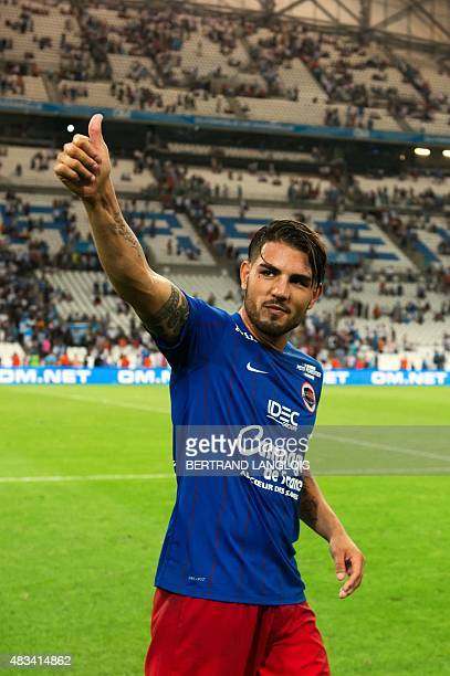 Caen's French forward Andy Delort acknowledges the audience following the French L1 football match between Olympique de Marseille and Stade Malherbe...