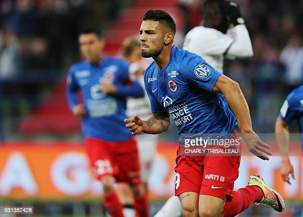 Caen's French forward Andy Delort celebrates after scoring a goal during the French Ligue 1 football match between Caen and Bordeaux on May 14 2016...