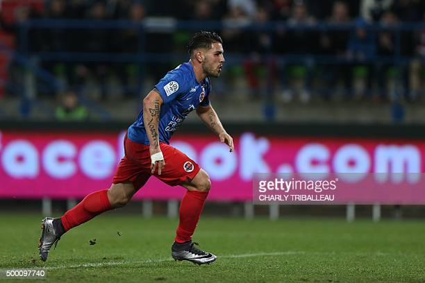 Caen's French forward Andy Delort celebrates after scoring a penalty kick during the French L1 football match between Caen and Lille on December 5 at...