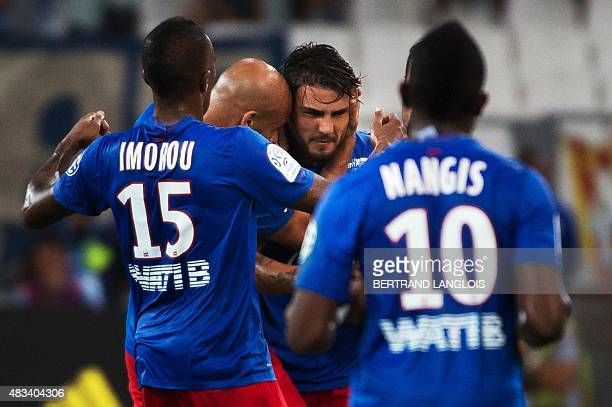 Caen's French forward Andy Delort celebrates after scoring during the French L1 football match between Olympique de Marseille and Stade Malherbe de...