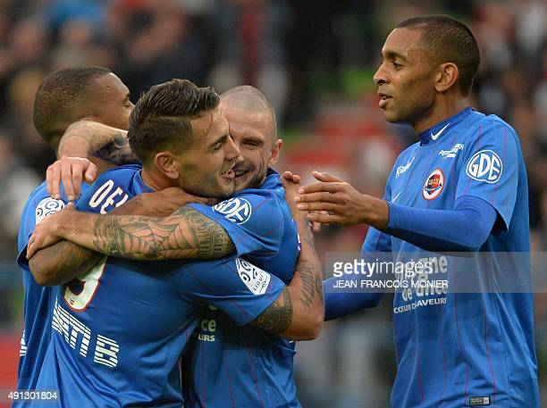 Caen's French forward Andy Delort celebrates with Caen's French midfielder Vincent Bessat and Caen's French forward Sylvio Ronny Rodelin after...