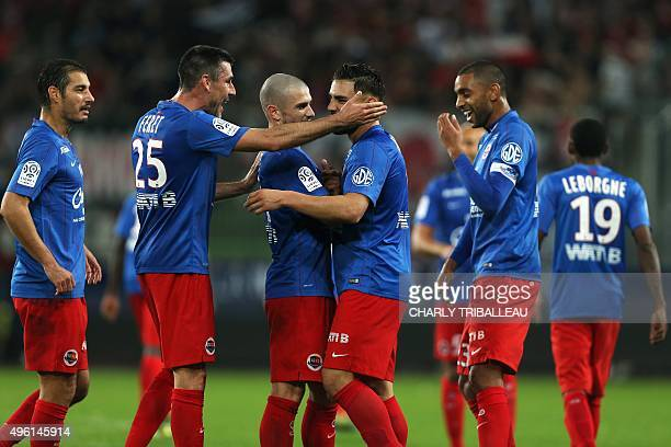 Caen's French forward Andy Delort is congratulated by teammates after scoring during the French L1 football match between Caen and Guingamp on...