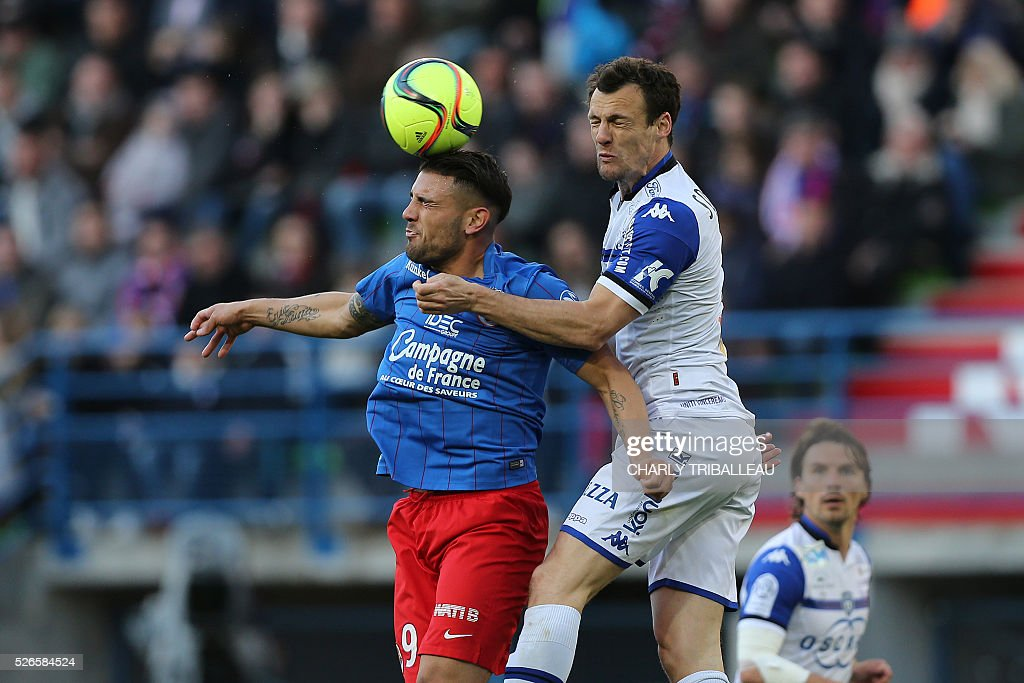 Caen's French forward Andy Delort (L) jumps for the ball with Bastia's French defender Sebastien Squillaci during the French L1 football match between Caen (SM Caen) and Bastia (SC Bastia), on April 30, 2016 at the Michel d'Ornano stadium, in Caen, northwestern France. /