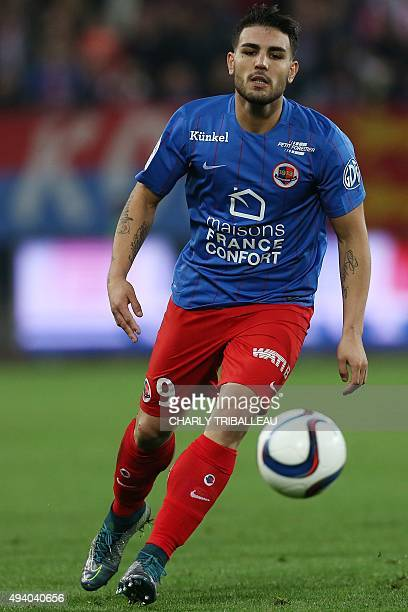 Caen's French forward Andy Delort passes the ball during the French L1 football match between Caen and Nantes on October 23 at the Michel d'Ornano...
