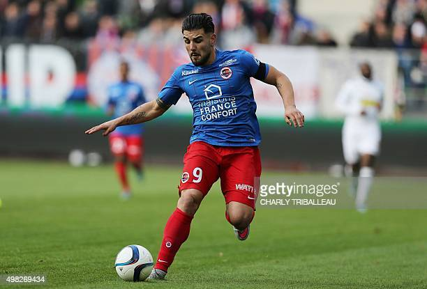 Caen's French forward Andy Delort runs with the ball during the French L1 football match between Caen and Angers on November 22 at the Michel...
