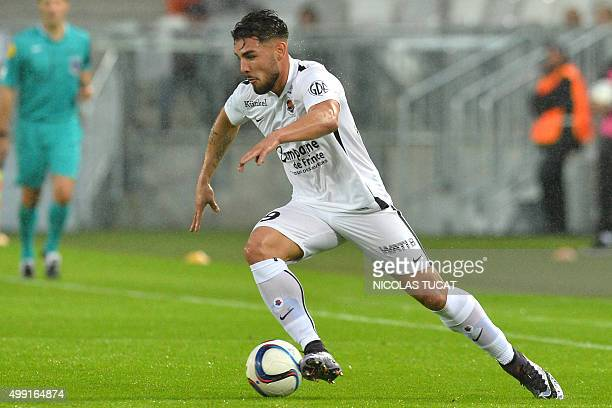 Caen's French forward Andy Delort runs with the ball during the French Ligue1 football match between Bordeaux and Caen on November 29 2015 at the...