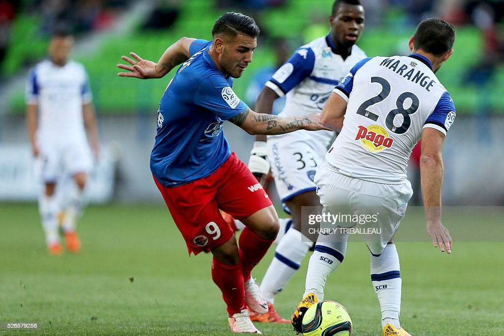 Caen's French forward Andy Delort (L) vies for the ball with Bastia's French defender Florian Marange during the French L1 football match between Caen (SMC) and Bastia (SCB) on April 30, 2016, at the Michel d'Ornano Stadium in Caen, northwestern France.