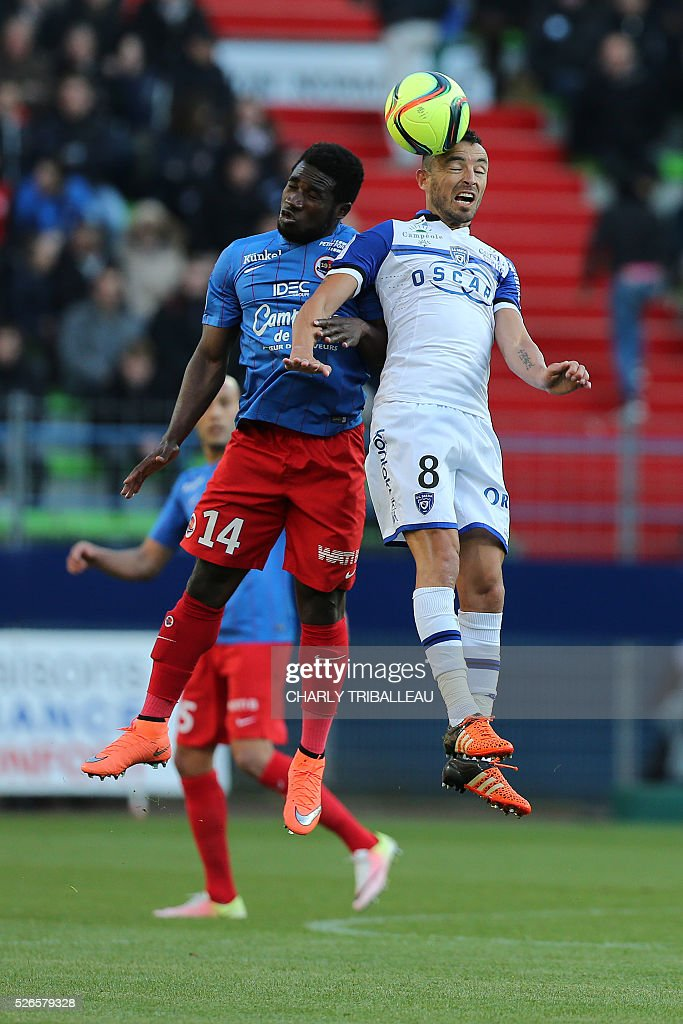 Caen's French forward Andy Delort (C) vies for the ball with Bastia's French defender Sebastien Squillaci (R) during the French L1 football match between Caen (SMC) and Bastia (SCB) on April 30, 2016, at the Michel d'Ornano Stadium in Caen, northwestern France.