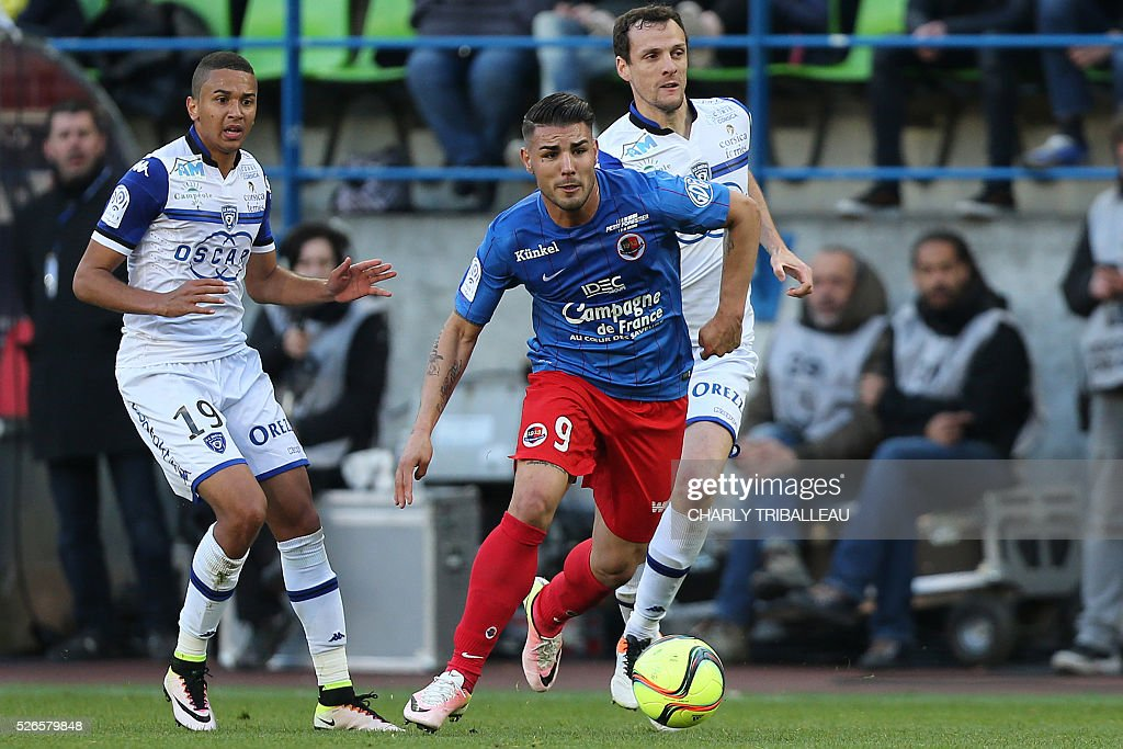 Caen's French forward Andy Delort (C) vies for the ball with Bastia's French midfielder Axel Ngando (L) and Bastia's French defender Sebastien Squillaci (R) during the French L1 football match between Caen (SMC) and Bastia (SCB) on April 30, 2016, at the Michel d'Ornano Stadium in Caen, northwestern France.
