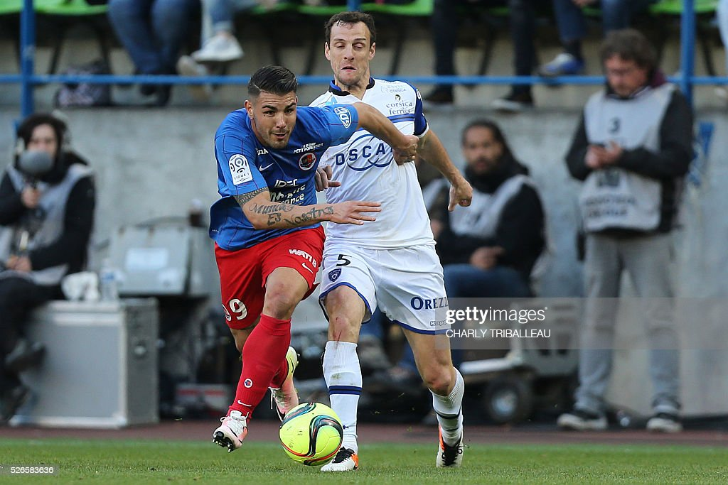 Caen's French forward Andy Delort (L) vies for the ball with Bastia's French defender Sebastien Squillaci during the French L1 football match between Caen (SMC) and Bastia (SCB) on April 30, 2016, at the Michel d'Ornano Stadium in Caen, northwestern France.