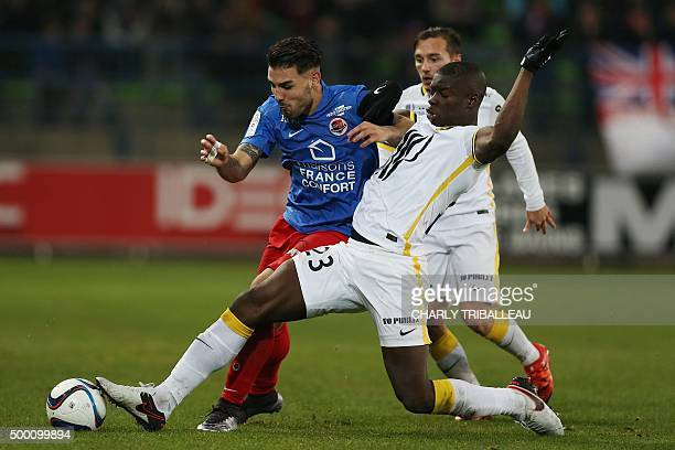 Caen's French forward Andy Delort vies with Lille's French defender Adama Soumaoro during the French L1 football match between Caen and Lille on...