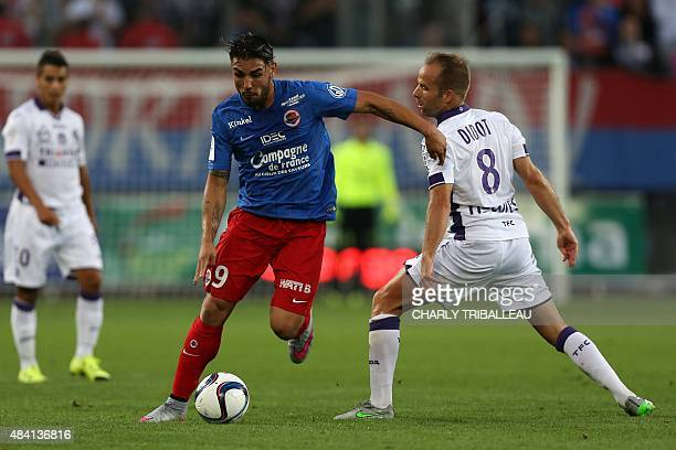Caen's French forward Andy Delort vies with Toulouse's French midfielder Etienne Didot during the French L1 football match between Stade Malherbe de...
