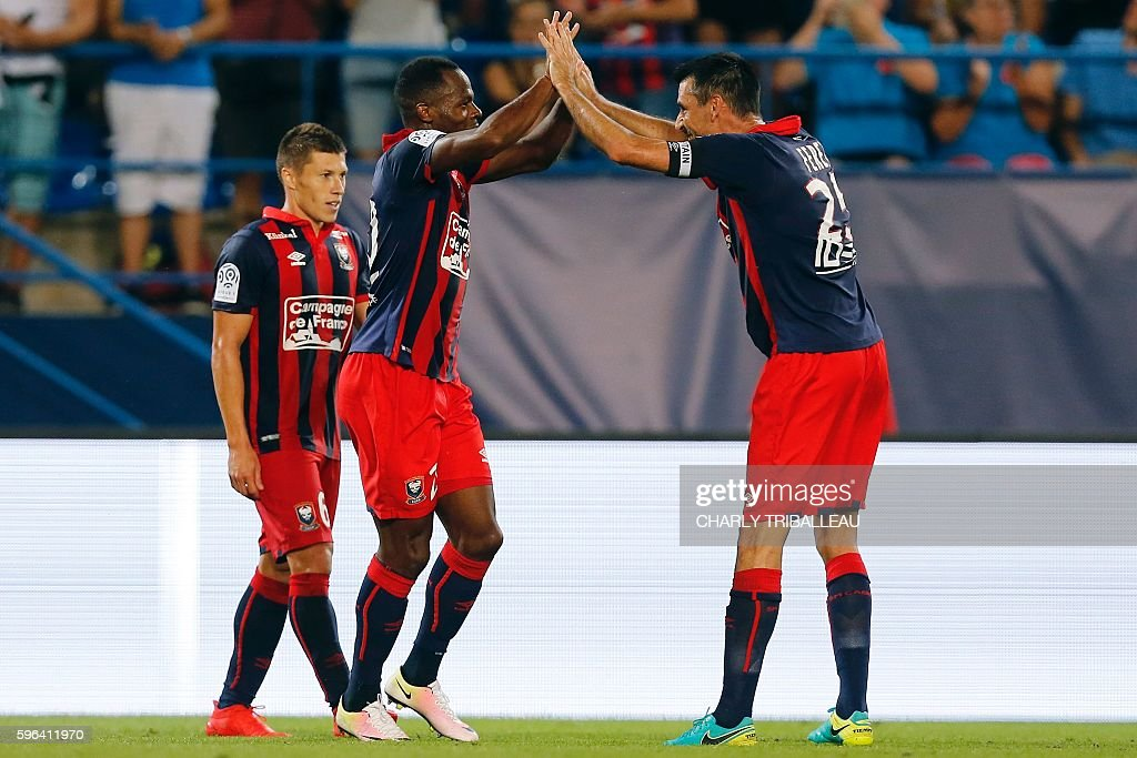 Caen's French forward Herve Bazile celebrates with his teammate Caen's French midfielder Julien Feret after scoring a goal during the French L1...