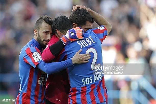 Caen's French forward Nicolas Benezet Caen's French midfielder Nicolas Seube and Caen's French goalkeeper Remy Vercoutre celebrate their team's...
