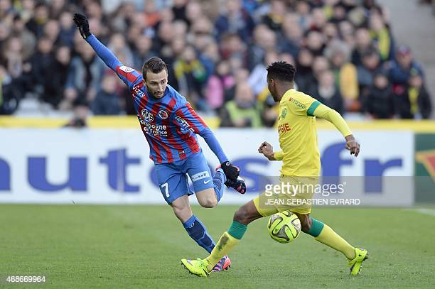 Caen's French forward Nicolas Benezet vies with Nantes' French midfielder Georges Kevin Nkoudou during the French L1 football match between Nantes...