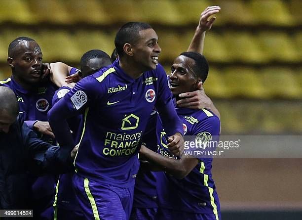 Caen's French forward Sylvio Ronny Rodelin celebrates with teammates after scoring a goal during the French L1 football match between Monaco and Caen...