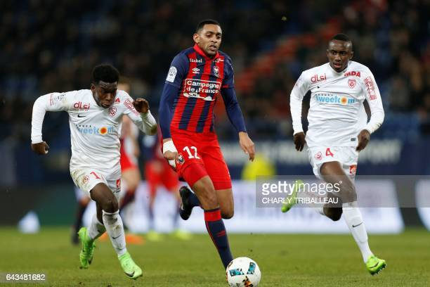 Caen's French forward Sylvio Ronny Rodelin vies for the ball with Nancy's French defender Faitout Maouassa and Nancy's French defender Modou Diagne...