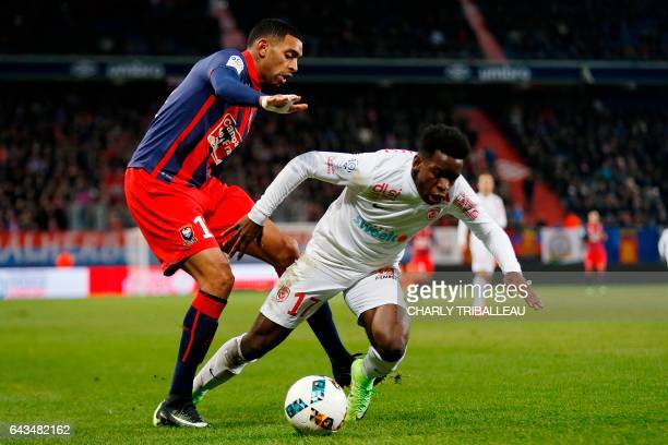 Caen's French forward Sylvio Ronny Rodelin vies for the ball with Nancy's French defender Faitout Maouassa during the French L1 football match...