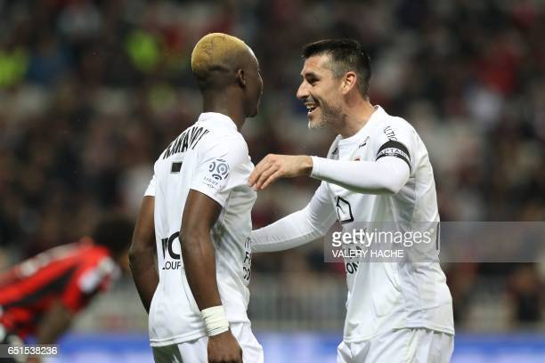 Caen's French forward Yann Karamoh celebrates after scoring a goal during the French L1 football match Nice vs Caen on March 10 2017 at the Allianz...