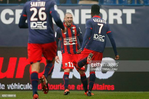 Caen's French forward Yann Karamoh celebrates with teammates after scoring a goal during the French L1 football match between Caen and Metz on...