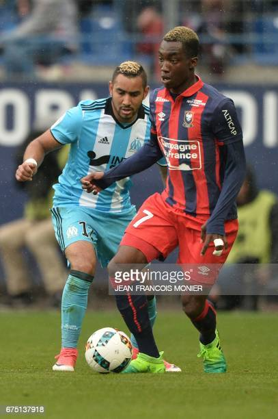 Caen's French forward Yann Karamoh outruns Marseille's French forward Dimitri Payet during the French L1 football match Caen vs Marseille on April 30...