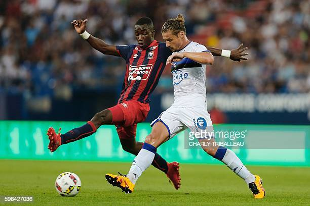 Caen's French forward Yann Karamoh vies for the ball with Bastia's Algerian midfielder Mehdi Mostefa during the French L1 football match between Caen...