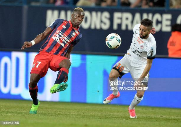 Caen's French forward Yann Karamoh vies for the ball with Montpellier's French midfielder Ryad Boudebouz during the French L1 football match between...