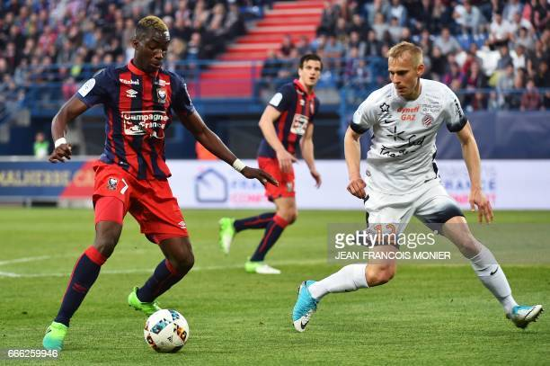 Caen's French forward Yann Karamoh vies for the ball with Montpellier's Czech defender Lukas Pokorny during the French L1 football match between Caen...