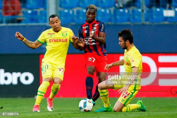 Caen's French forward Yann Karamoh vies Nantes' Edgar Pardo Castro and Nantes' French defender Leo Dubois during the French L1 football match between...