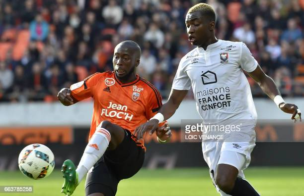 Caen's French forward Yann Karamoh vies with Lorient's French defender Erwin Koffi during the French L1 football match Lorient vs Caen at the...