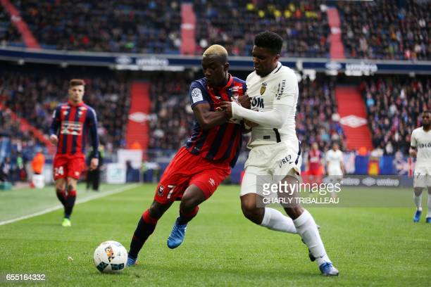 Caen's French forward Yann Karamoh vies with Monaco's Brazilian defender Jemerson during the French L1 football match between Caen and Monaco on...