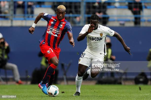 Caen's French forward Yann Karamoh vies with Monaco's French defender Benjamin Mendy during the French L1 football match between Caen and Monaco on...