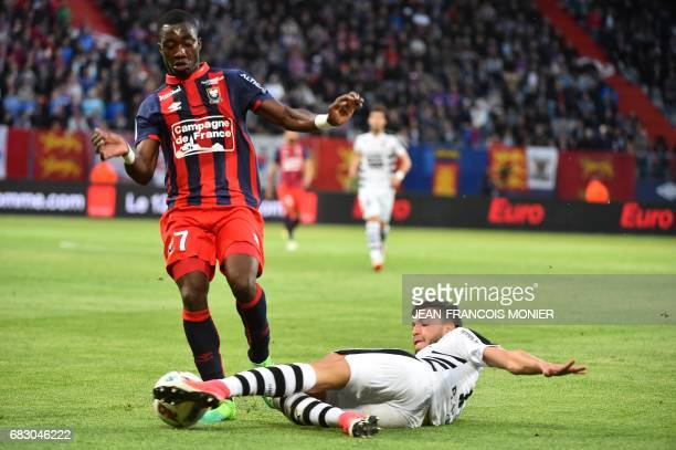 Caen's French forward Yann Karamoh vies with Rennes' Algerian defender Ramy Bensebaini during the French L1 football match between Caen and Rennes on...