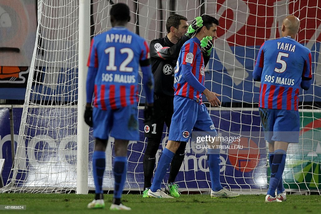 Caen's French goalkeeper <a gi-track='captionPersonalityLinkClicked' href=/galleries/search?phrase=Remy+Vercoutre&family=editorial&specificpeople=684756 ng-click='$event.stopPropagation()'>Remy Vercoutre</a> and Caen's French midfielder <a gi-track='captionPersonalityLinkClicked' href=/galleries/search?phrase=Julien+Feret&family=editorial&specificpeople=4110266 ng-click='$event.stopPropagation()'>Julien Feret</a> react during the French L1 football match between Caen (SM Caen) and Reims (RS), on January 17, 2015, at the Michel d'Ornano stadium, in Caen, northwestern France.