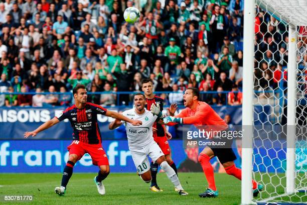 Caen's French goalkeeper Remy Vercoutre saves a ball in front of his teammate French defender Damien Da Silva and SaintEtienne's French forward...