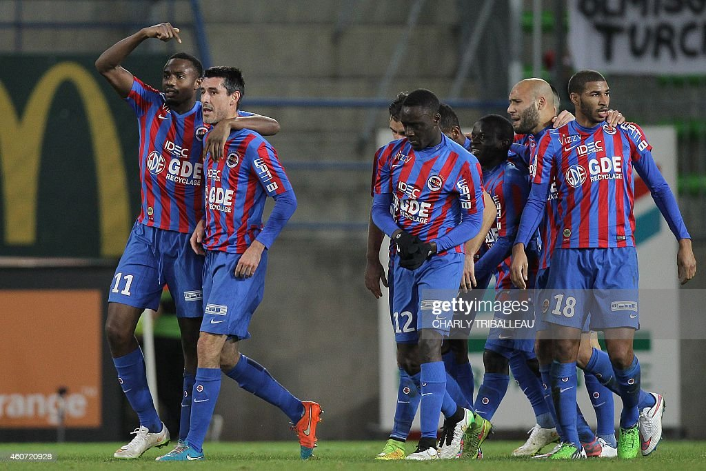Caen's French Guinean forward Bangaly-Fode Koita (L) celebrates with French midfielder <a gi-track='captionPersonalityLinkClicked' href=/galleries/search?phrase=Julien+Feret&family=editorial&specificpeople=4110266 ng-click='$event.stopPropagation()'>Julien Feret</a> (2nd L) after Feret scored a goal during the French L1 football match Caen (SMC) vs Bastia (SCB) on December 20, 2014 at the Michel d'Ornano stadium in Caen. AFP PHOTO / CHARLY TRIBALLEAU