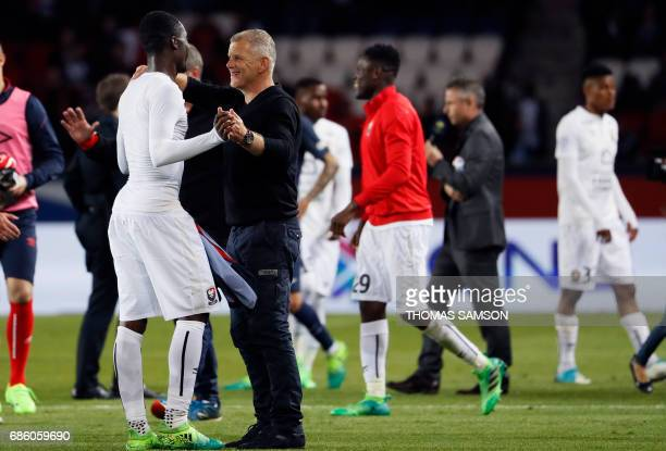 Caen's French head coach Patrice Garande and Caen's French forward Yann Karamoh react at the end of the French L1 football match between Paris...