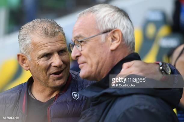 Caen's French head coach Patrice Garande chats with Nantes' Italian head coach Claudio Ranieri the French L1 football match Nantes against Caen on...