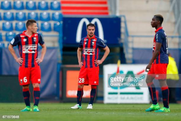 Caen's French midfielder Jonathan Delaplace Caen's French defender Damien Da Silva and Caen's French forward Yann Karamoh react at the end of the...