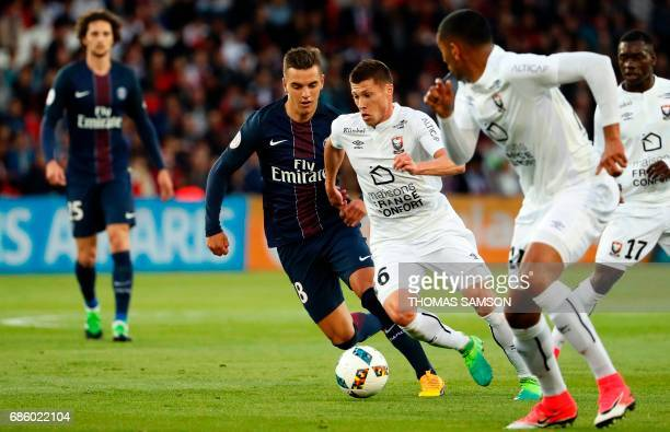 Caen's French midfielder Jonathan Delaplace vies with Paris SaintGermain's Giovani Lo Celso during the French L1 football match between Paris...