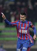 Caen's French midfielder Julien Feret celebrates after scoring a goal during the French L1 football match between Caen and Lens on February 21 2015...