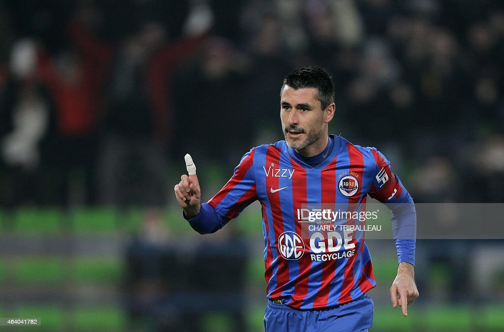 Caen's French midfielder <a gi-track='captionPersonalityLinkClicked' href=/galleries/search?phrase=Julien+Feret&family=editorial&specificpeople=4110266 ng-click='$event.stopPropagation()'>Julien Feret</a> celebrates after scoring a goal during the French L1 football match between Caen (SMC) and Lens (RCL) on February 21, 2015 at the Michel d'Ornano stadium in Caen, northwestern France.